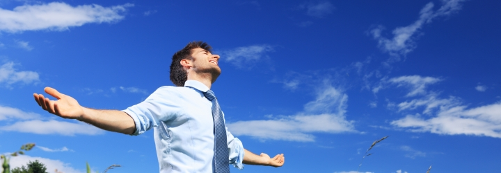Young business man enjoying the fresh air on a sunny day